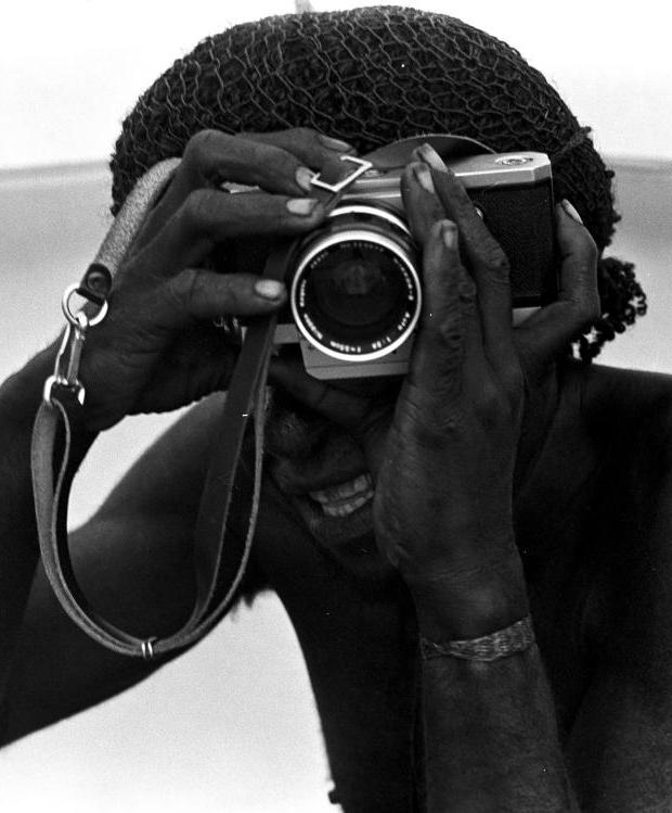 Indigenous man with camera